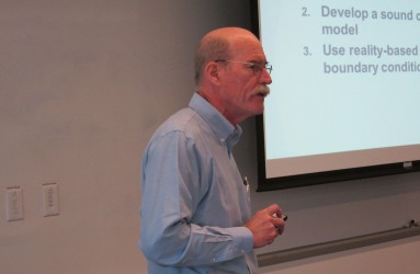 Pete Shanahan discusses modeling fundamentals with U.S. NRC staff at the 2015 training course.