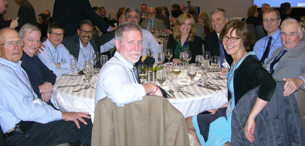 John Till (right) and Helen Grogan (2nd from right at front) at the Members' Dinner during the 2019 NCRP annual meeting