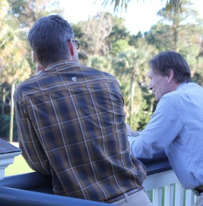 Mark Packard and Jim Rocco continue a discussion outside the meeting room at Kiawah Island, SC.